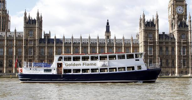 Golden Flame party boat underneath the London Eye on the Thames